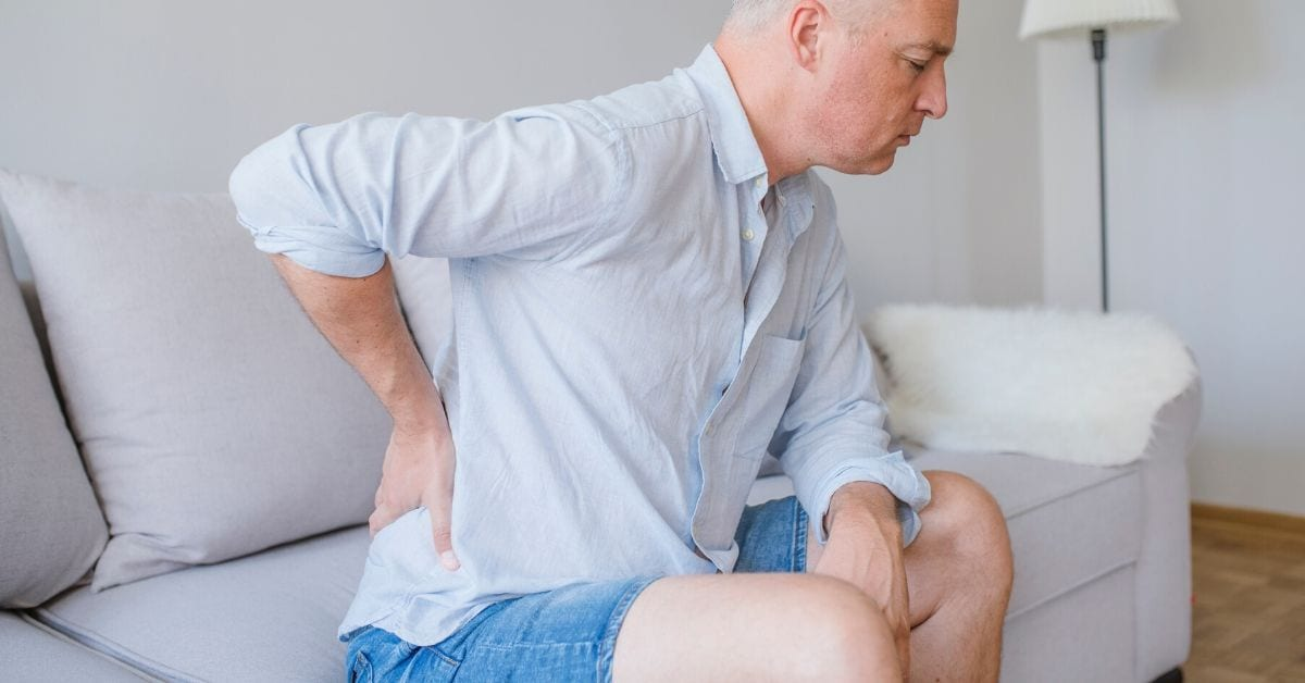 man with back pain from post surgical pain